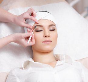 f1898de6c5a Permanent makeup. Permanent make-up wizard makes eyebrow correction  procedure. Beautiful young woman